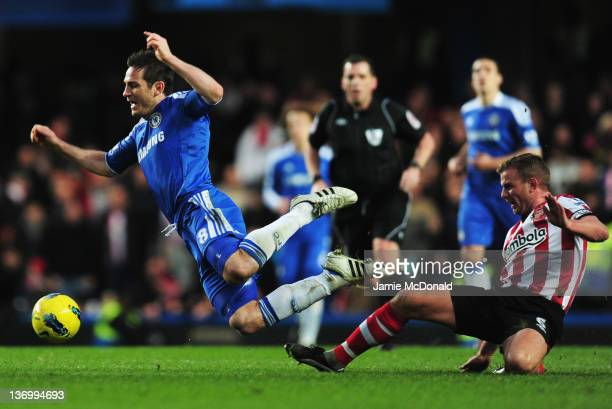 Frank Lampard of Chelsea is tripped by Lee Cattermole of Sunderland during the Barclays Premier League match between Chelsea and Sunderland at...