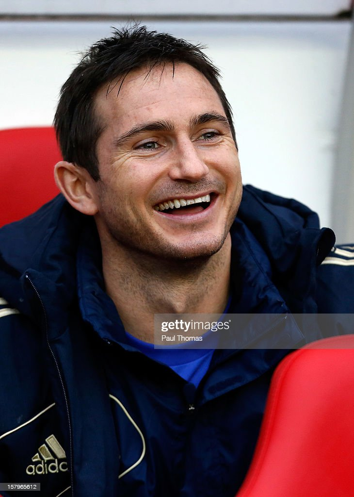 Frank Lampard of Chelsea laughs as he sits in the dug out before the Barclays Premier League match between Sunderland and Chelsea at the Stadium of Light on December 8, 2012, in Sunderland, England.