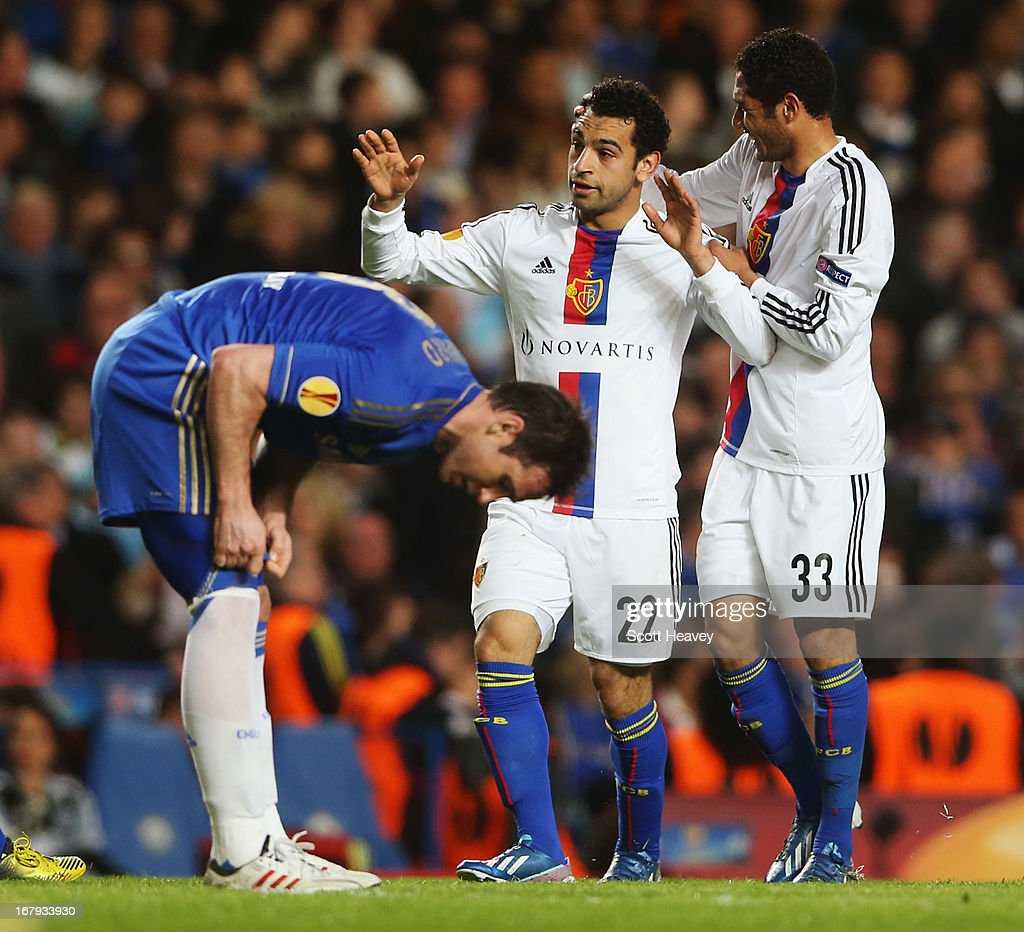 Frank Lampard of Chelsea looks despondent Mohamed Salah of Basel (22) celebrates with Mohamed Elneny (33) as he scores their first goal during the UEFA Europa League semi-final second leg match between Chelsea and FC Basel 1893 at Stamford Bridge on May 2, 2013 in London, England.