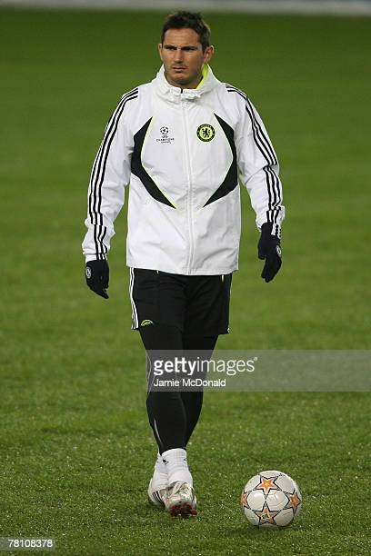 Frank Lampard of Chelsea looks on during a Chelsea training and press conference prior to tomorrow's Champions League Group B match against Rosenborg...