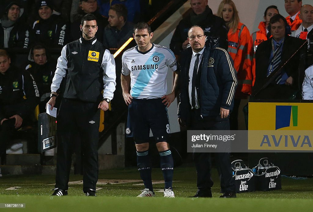 Frank Lampard of Chelsea prepares to come on as Rafael Benitez, interim manager of Chelsea looks on during the Barclays Premier League match between Norwich City and Chelsea at Carrow Road on December 26, 2012 in Norwich, England.