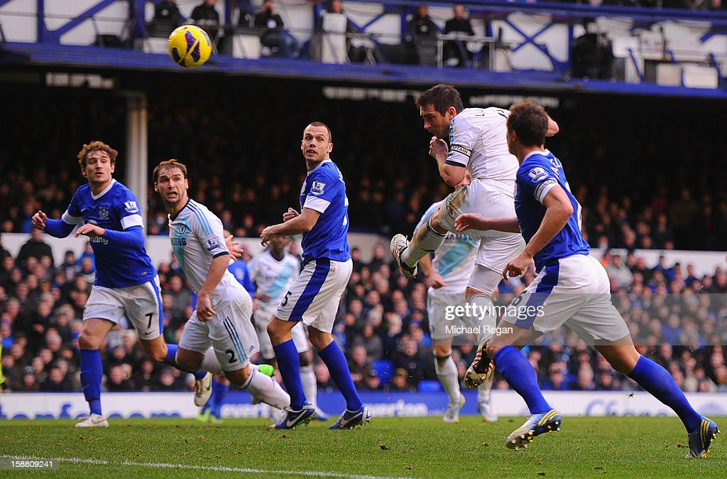 Frank Lampard of Chelsea scores his team's first goal to make the score 1-1 during the Barclays Premier League match between Everton and Chelsea at Goodison Park on December 30, 2012 in Liverpool, England.