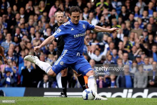 Frank Lampard of Chelsea scores his team's second goal from the penalty spot after being brought down by Gary Caldwell of Wigan during the Barclays...