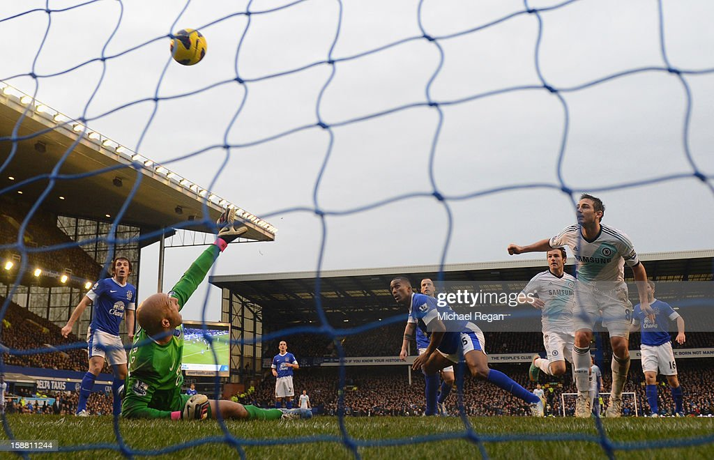 Frank Lampard of Chelsea scores his team's second goal to make the score 1-2 during the Barclays Premier League match between Everton and Chelsea at Goodison Park on December 30, 2012 in Liverpool, England.