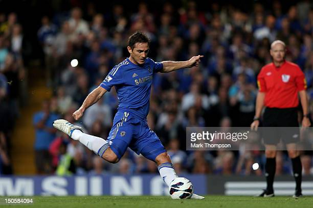 Frank Lampard of Chelsea scores the opening goal from the penalty spot during the Barclays Premier League match between Chelsea and Reading at...