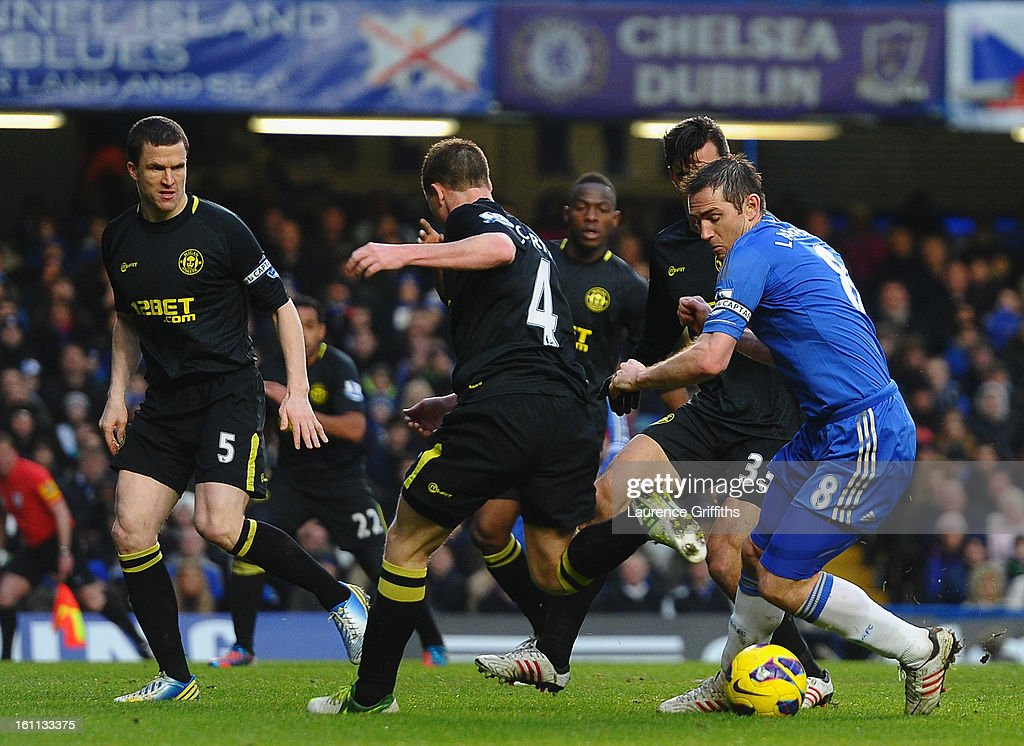 Frank Lampard of Chelsea takes on the Wigan back four during the Barclays Premier League match between Chelsea and Wigan Athletic at Stamford Bridge on February 9, 2013 in London, England.