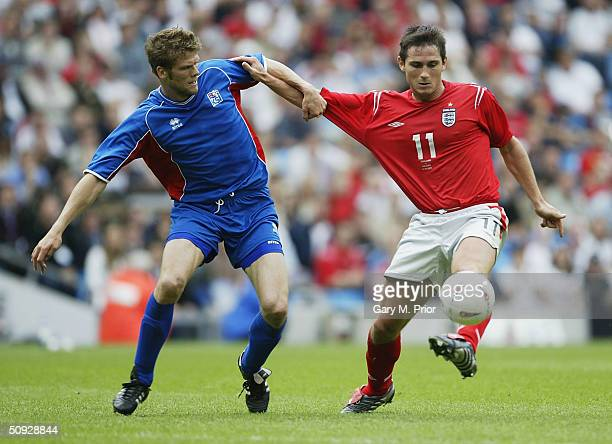 Frank Lampard of England and Hermann Hreidarsson of Iceland in action during the FA Summer Tournament match between England and Iceland at the City...