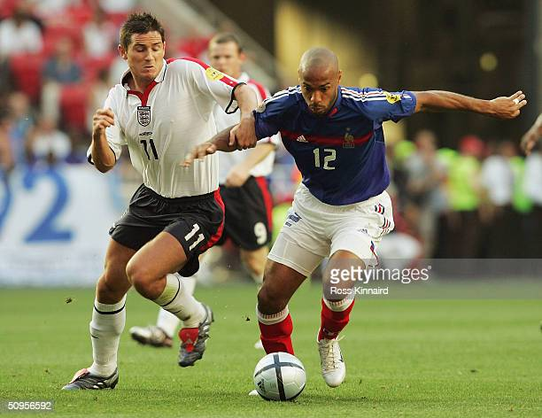 Frank Lampard of England battles with Thierry Henry of France during the France v Englnd Group B match in the 2004 UEFA European Football...