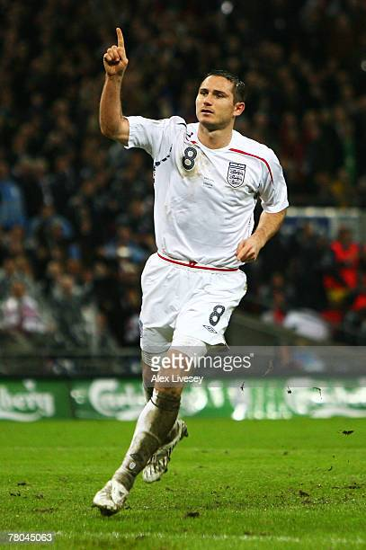 Frank Lampard of England celebrates as he scores their first goal from a penalty during the Euro 2008 Group E qualifying match between England and...