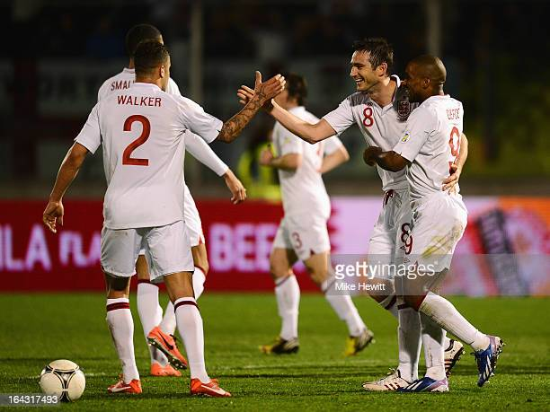 Frank Lampard of England celebrates his goal with Kyle Walker and Jermain Defoe during the FIFA 2014 World Cup Qualifier Group H match between San...