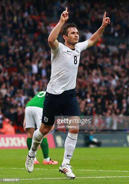 Frank Lampard of England celebrates scoring his team's first goal to make the score 11 during the International Friendly match between England and...