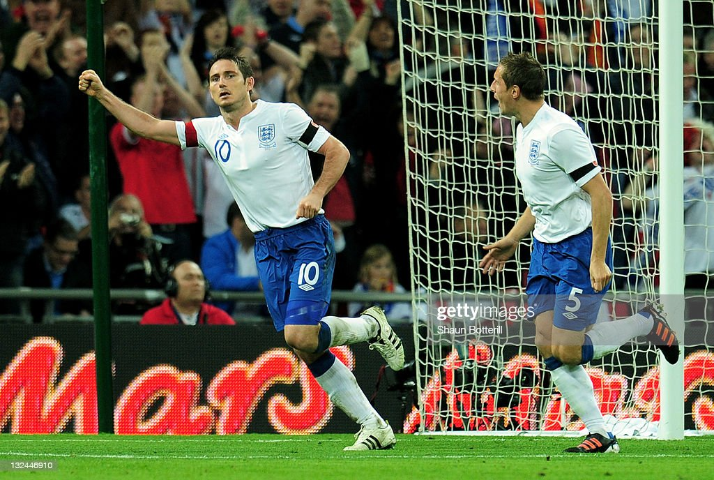 Frank Lampard of England (10) celebrates with Phil Jagielka (5) as scores their first goal during the international friendly match between England and Spain at Wembley Stadium on November 12, 2011 in London, England.