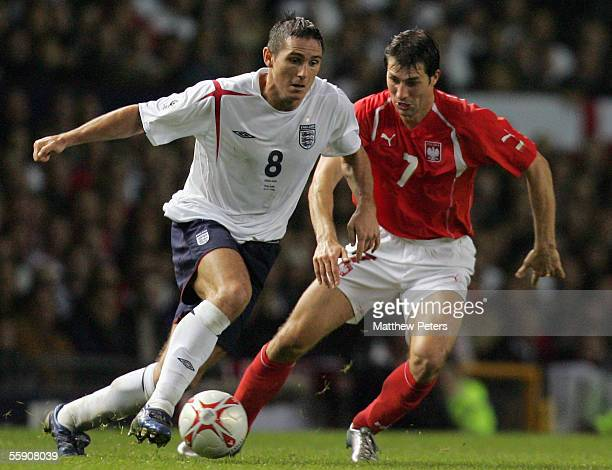 Frank Lampard of England clashes with Radoslaw Sobolewski of Poland during the World Cup qualifying match between England and Poland at Old Trafford...