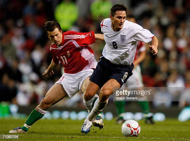 Frank Lampard of Englkand is challenged by Hungary's Szabolcs Huszti during the International Friendly match between England and Hungary at Old...
