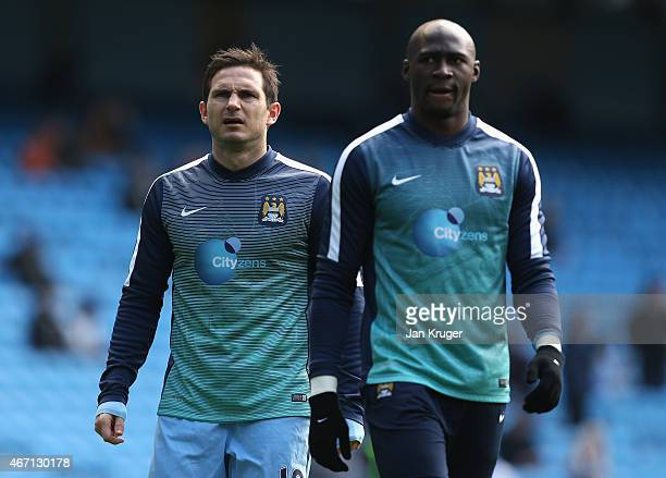 Frank Lampard of Manchester City and Eliaquim Mangala of Manchester City warm up prior to the Barclays Premier League match between Manchester City...