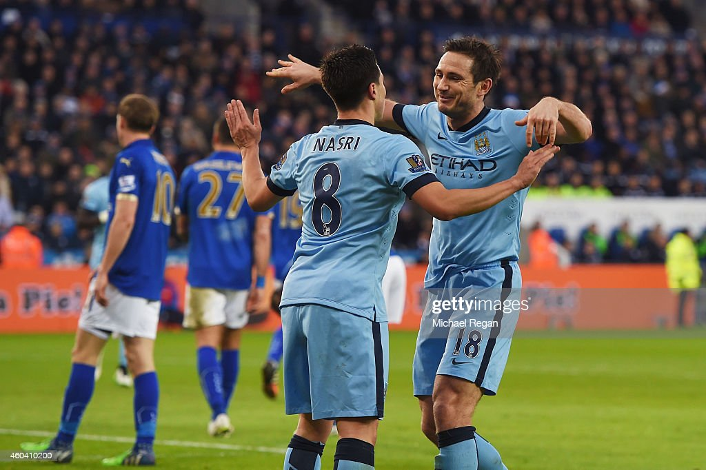 Frank Lampard of Manchester City celebrate Samir Nasri of Manchester City after scoring the opening goal during the Barclays Premier League match...