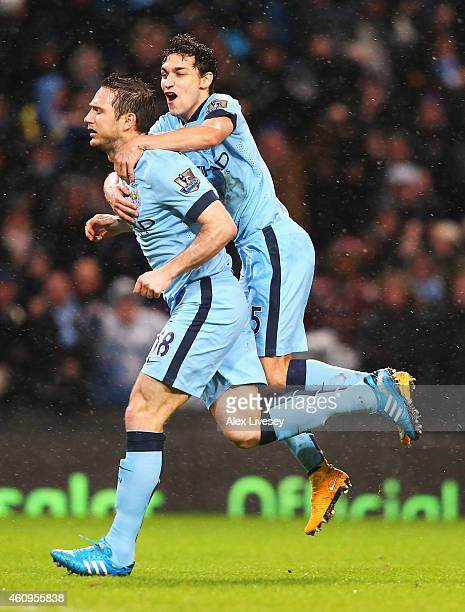 Frank Lampard of Manchester City celebrates his team's third goal with Jesus Navas during the Barclays Premier League match between Manchester City...