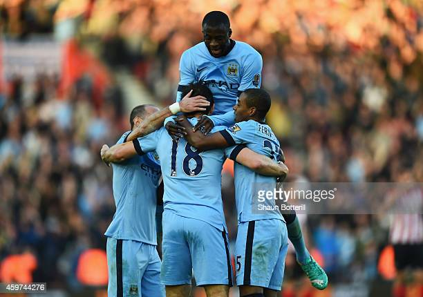 Frank Lampard of Manchester City celebrates with Pablo Zabaleta Yaya Toure and Fernandinho as he scores their second goal during the Barclays Premier...