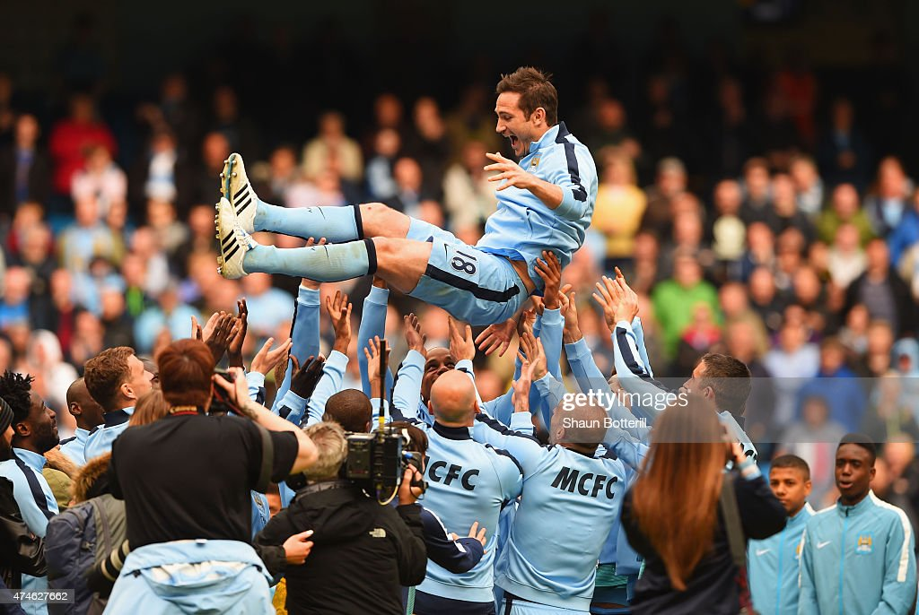 Frank Lampard of Manchester City is thrown into the air by his team mates after the Barclays Premier League match between Manchester City and Southampton at Etihad Stadium on May 24, 2015 in Manchester, England.