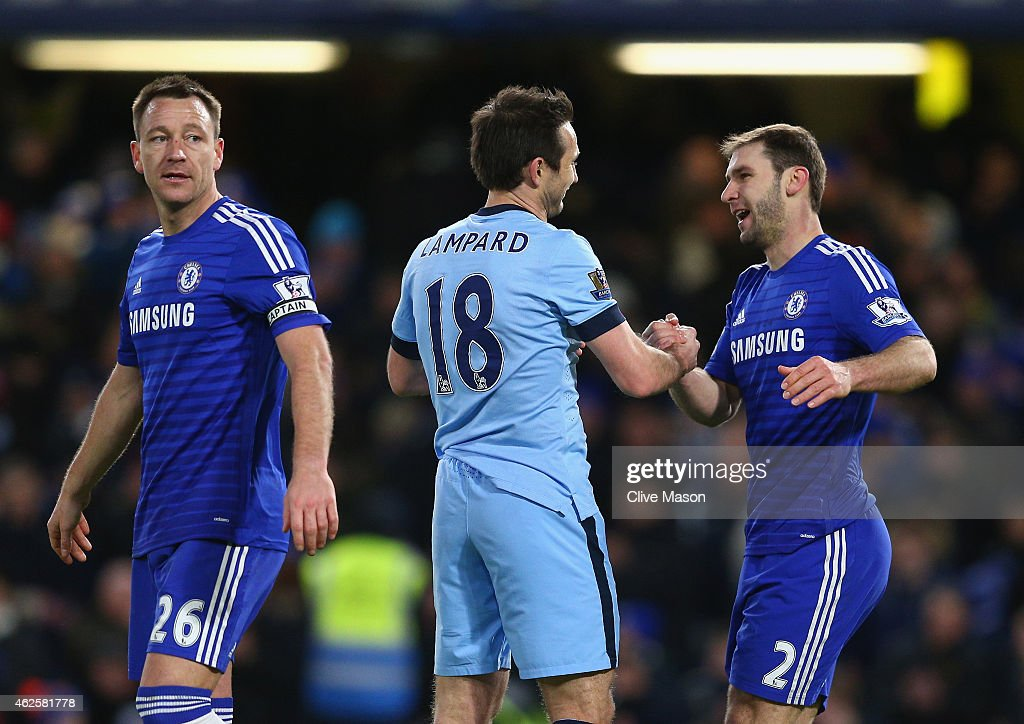 Frank Lampard of Manchester City moves to embraces Branislav Ivanovic of Chelsea as John Terry of Chelsea looks on at the final whistle of the...