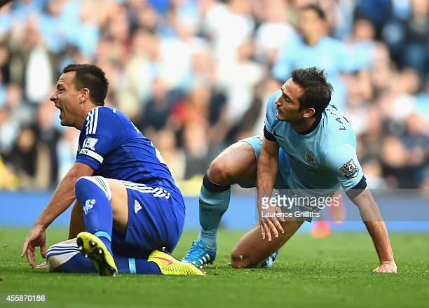 Frank Lampard of Manchester City scores the equalising goal as John Terry of Chelsea shows his dismay during the Barclays Premier League match...