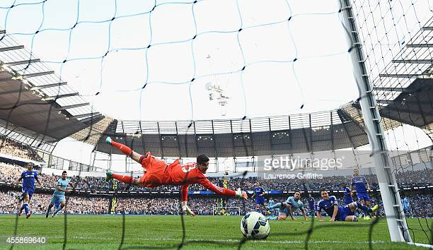 Frank Lampard of Manchester City scores the equalising goal past Thibaut Courtois of Chelsea during the Barclays Premier League match between...