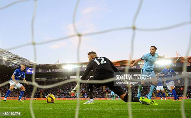Frank Lampard of Manchester City scores the opening goal past goalkeeper Ben Hamer of Leicester City during the Barclays Premier League match between...
