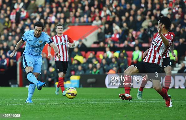 Frank Lampard of Manchester City shoots past Maya Yoshida of Southampton to score their second goal during the Barclays Premier League match between...
