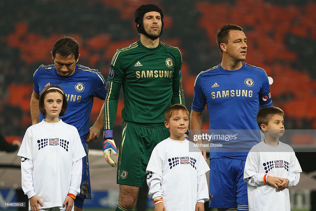Frank Lampard (L), Petr Cech (C) and John Terry (R) of Chelsea line up with mascots ahead of the UEFA Champions League Group E match between Shakhtar Donetsk and Chelsea at the Donbass Arena on October 23, 2012 in Donetsk, Ukraine.