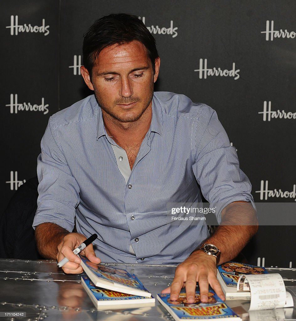 <a gi-track='captionPersonalityLinkClicked' href=/galleries/search?phrase=Frank+Lampard+-+Born+1978&family=editorial&specificpeople=11497645 ng-click='$event.stopPropagation()'>Frank Lampard</a> poses at a photocall ahead of signing copies of his book 'Frankie's Magic football' at Harrods on June 22, 2013 in London, England.