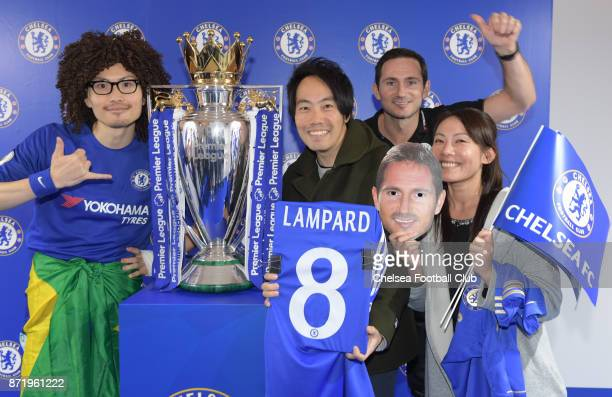 Frank Lampard seen photo bombing fans as they have their photos taken with the Premier League Cup at the Shidome Centre on November 9 2017 in Tokyo...