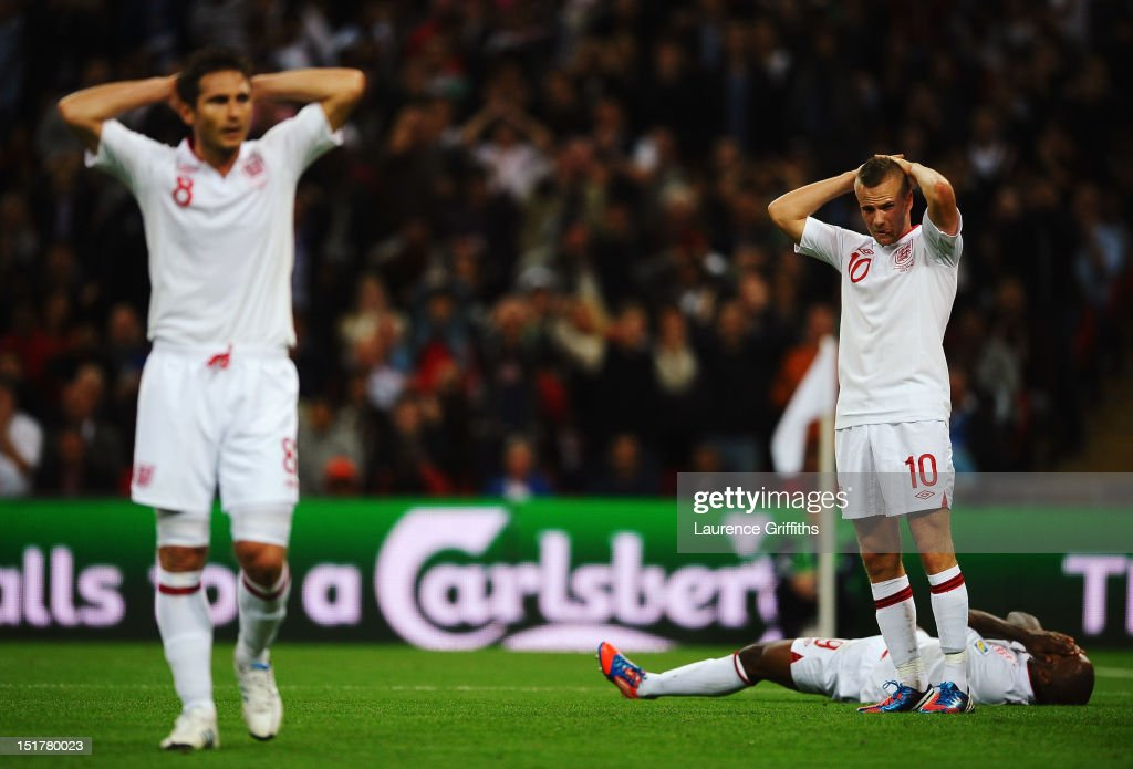 Frank Lampard, Tom Cleverley and Jermain Defoe of England react as Cleverley misses a chance during the FIFA 2014 World Cup Group H qualifying match between England and Ukraine at Wembley Stadium on September 11, 2012 in London, England.