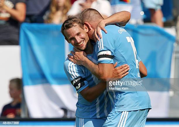 Frank Loening of Chemnitz jubilates with team mate Anton Fink after scoring the fived goal during the third league match between Chemnitzer FC and...