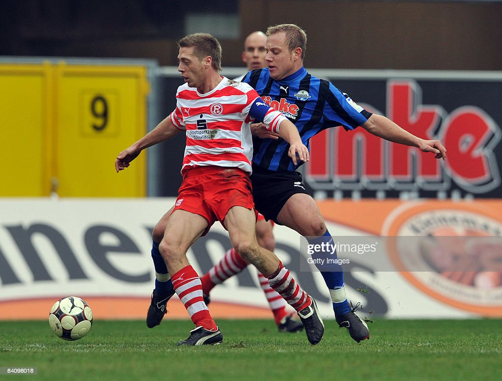Frank Loening of Paderborn fights for the ball with Andreas Lampertz of Duesseldorf during the 3 Liga match between SC Paderborn and Fortuna...