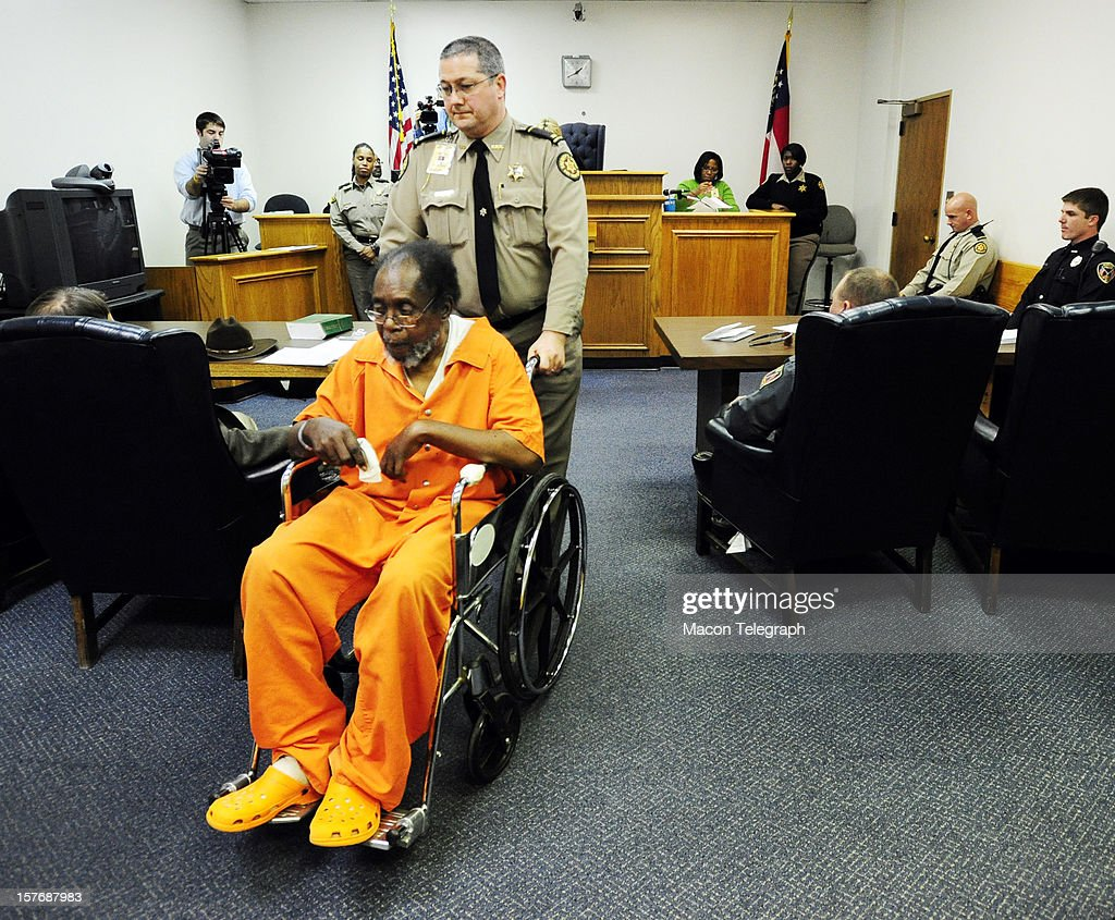 Frank Louis Reeves is wheeled out of the courtroom Wednesday, December 5, 2012, after his first appearance in Macon, Georgia. Reeves is accused in the death of a woman outside a Gray Highway gas station after his motorized wheelchair bumped her car.