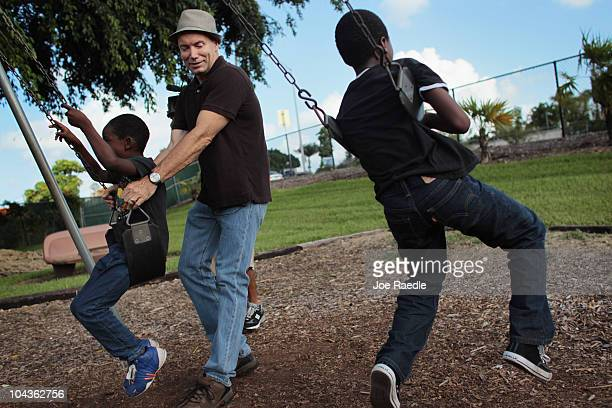 Frank Martin Gill plays with his foster sons known as NRG six years old and XXG 10 years old on the swings after the Third District Court of Appeal...
