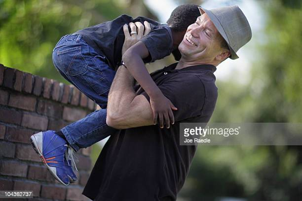 Frank Martin Gill plays with his sixyearold foster son known as NRG after the Third District Court of Appeal in Miami ruled earlier today that...