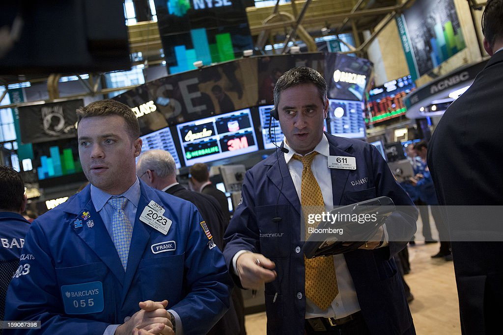 Frank Masiello, a trader with Barclays PLC, left, and Daniel Trimble, a trader with Greywolf Execution Partners Inc., work on the floor of the New York Stock Exchange (NYSE) in New York, U.S., on Monday, Jan. 7, 2013. U.S. stocks fell, after the Standard & Poor's 500 Index climbed to a five-year high, as investors awaited the start of the corporate earnings season tomorrow. Photographer: Scott Eells/Bloomberg via Getty Images