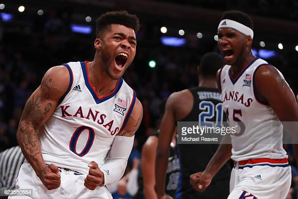 Frank Mason III and Carlton Bragg Jr #15 of the Kansas Jayhawks react after a foul against the Duke Blue Devils in the second half during the State...