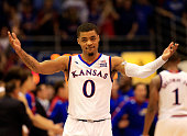 Frank Mason III of the Kansas Jayhawks celebrates as the Jayhawks defeat the West Virginia Mountaineers 7669 in overtime to win the game and clinch...