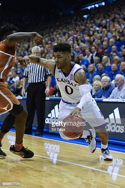 Frank Mason III of the Kansas Jayhawks drives to basket against Andrew Jones of the Texas Longhorns at Allen Fieldhouse on January 21 2017 in...