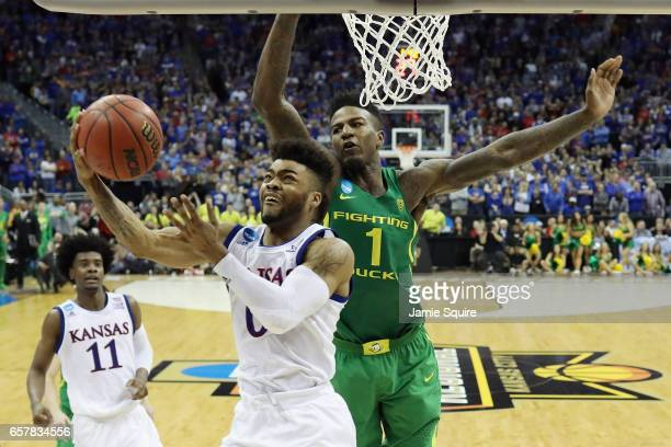 Frank Mason III of the Kansas Jayhawks drives to the basket against Jordan Bell of the Oregon Ducks in the second half during the 2017 NCAA Men's...