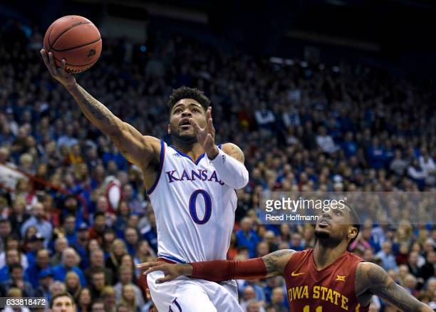 Frank Mason III of the Kansas Jayhawks goes up for a shot past Monte Morris of the Iowa State Cyclones on February 4 2017 at Allen Field House in...