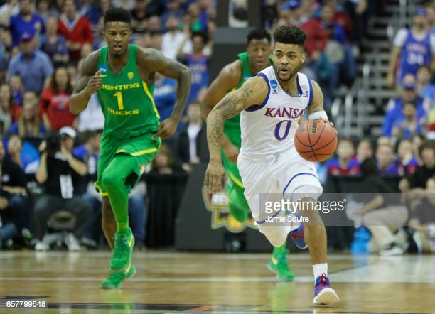 Frank Mason III of the Kansas Jayhawks handles the ball against the Oregon Ducks during the 2017 NCAA Men's Basketball Tournament Midwest Regional at...