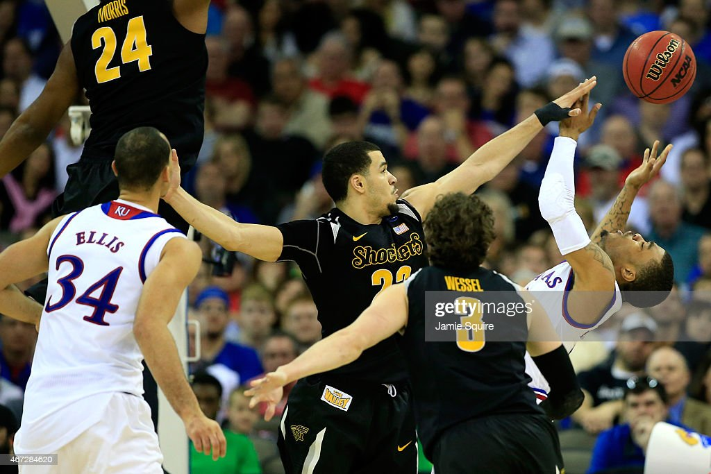 <a gi-track='captionPersonalityLinkClicked' href=/galleries/search?phrase=Frank+Mason+III&family=editorial&specificpeople=13735967 ng-click='$event.stopPropagation()'>Frank Mason III</a> #0 of the Kansas Jayhawks has a shot blocked by <a gi-track='captionPersonalityLinkClicked' href=/galleries/search?phrase=Fred+VanVleet&family=editorial&specificpeople=10612238 ng-click='$event.stopPropagation()'>Fred VanVleet</a> #23 of the Wichita State Shockers in the second half during the third round of the 2015 NCAA Men's Basketball Tournament at the CenturyLink Center on March 22, 2015 in Omaha, Nebraska.