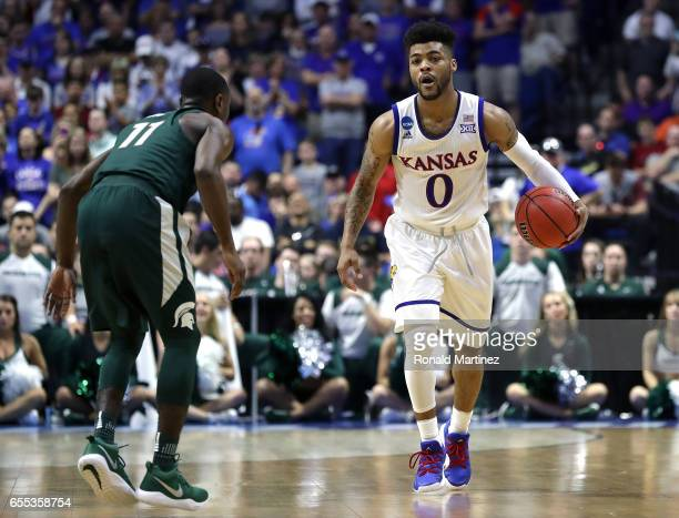 Frank Mason III of the Kansas Jayhawks is defended by Lourawls Nairn Jr #11 of the Michigan State Spartans during the second round of the 2017 NCAA...