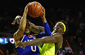Frank Mason III of the Kansas Jayhawks is fouled by Johnathan Motley of the Baylor Bears during the second half at Ferrell Center on February 23 2016...