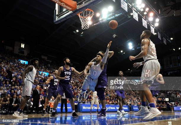 Frank Mason III of the Kansas Jayhawks lays the ball up against Alex Robinson Karviar Shepherd and JD Miller of the TCU Horned Frogs in the first...