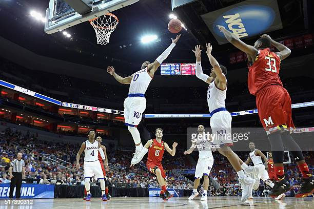 Frank Mason III of the Kansas Jayhawks rebounds the ball against the Maryland Terrapins during the 2016 NCAA Men's Basketball Tournament South...