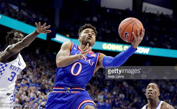 Frank Mason III of the Kansas Jayhawks shoots the ball against the Kentucky Wildcats during the game against at Rupp Arena on January 28 2017 in...